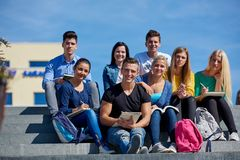 Students outside sitting on steps Stock Image