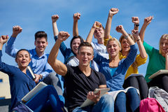 Students outside sitting on steps Stock Photography