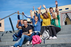 Students outside sitting on steps. Group portrait  of happy  students outside in front of school sitting on steps have fun Royalty Free Stock Photos