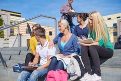 Students outside sitting on steps Royalty Free Stock Image