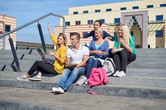 Students outside sitting on steps Stock Photos