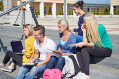 Students outside sitting on steps. Group portrait  of happy  students outside sitting on steps have fun Royalty Free Stock Photography