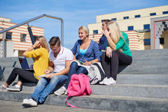 Students outside sitting on steps. Group portrait  of happy  students outside sitting on steps have fun Stock Image