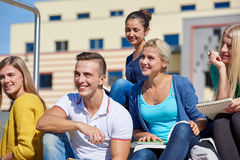Students outside sitting on steps. Group portrait  of happy  students outside sitting on steps have fun Royalty Free Stock Images