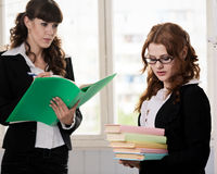 Students with papers and books Stock Images
