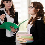 Students with papers and books Stock Photography