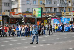 Students parade in Moscow in a sunny day. MOSCOW, RUSSIA - SEPTEMBER 08: 11th students parade in Moscow on Bolshaya Yakimanka street. Policeman watches the stock images
