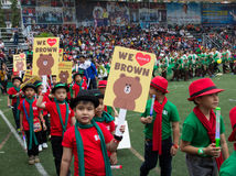 Students parade at school in Christmas Fair 2015. Bangkok, Thailand - December, 23 :Parents and students of St. Gabriel College parade at the school stadium in stock photos