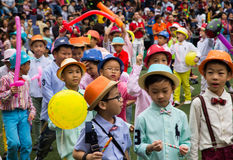 Students parade at school in Christmas Fair 2015. Bangkok, Thailand - December, 23 :Parents and students of St. Gabriel College parade at the school stadium in stock images