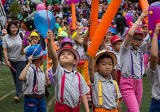 Students parade at school in Christmas Fair 2015. Bangkok, Thailand - December, 23 :Parents and students of St. Gabriel College parade at the school stadium in stock image