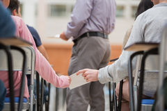 Students passing notes Stock Images