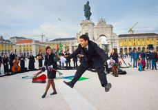 Students perform dance Lisbon Portugal. LISBON, PORTUGAL - DECEMBER 10, 2016: Group of teens dressed in traditional students uniform dancing and singing royalty free stock photography