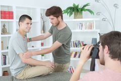 Students in photography working together on project royalty free stock image