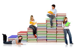 Students with a pile of books Stock Photography