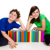Students and pile of books Royalty Free Stock Images