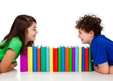 Students and pile of books Royalty Free Stock Photography