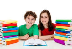 Students and pile of books Stock Photography