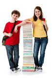Students and pile of books Royalty Free Stock Image