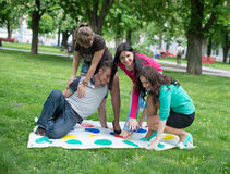 Students play a game in the park twister Royalty Free Stock Photo