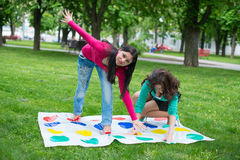 Students play a game in the park twister Stock Photos