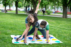 Students play a game in the park twister Stock Images