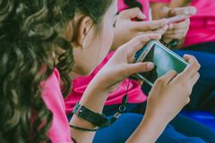 Students play games with mobile phones royalty free stock photography