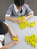 Students Playing With Dice In Class Royalty Free Stock Photo