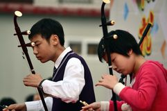 Chinese students playing erhu. Two students from Tianjin University high school China are playing erhu on campus culture festival photoed on April 28th 2013 Stock Images