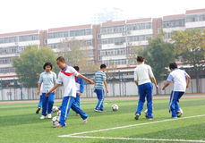 Students playing football Royalty Free Stock Images