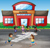 Students playing hopscotch at school Stock Photo