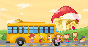 Students playing near the school bus Royalty Free Stock Photography