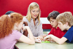 Students playing with teacher in class. Students playing with teacher in elementary school class stock images