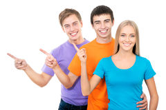 Students pointing on white background Royalty Free Stock Image
