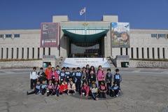 Students pose in front of War Memorial of Korea, Jeonjaeng ginyeomgwan, Yongsan-dong, Seoul, South Korea - NOVEMBER 2013 Stock Photos