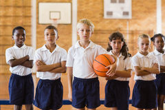 Students posing with arms crossed. In school gym Stock Photos