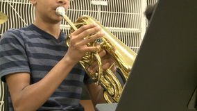 Students practicing in music class (3 of 7). A view or scene of School stock footage