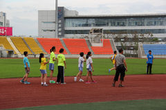 Students practise running In the sports center Stock Image