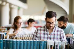 Students preparing the examinations. In a library royalty free stock images