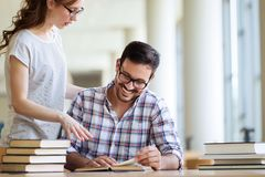 Students preparing the examinations. In a library Stock Image