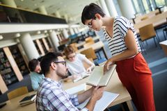 Students preparing the examinations. In a library Royalty Free Stock Photos