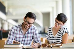 Students preparing together the examinations in a modern library royalty free stock photos