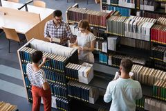 Students preparing together the examinations in a modern library. Students preparing the examinations in a library stock photography