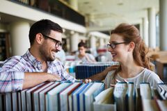 Students preparing the examinations. In a library Royalty Free Stock Image