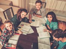 Students preparing for exams in home interior Stock Image