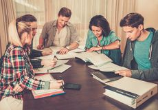 Students preparing for exams in home interior Stock Photo