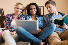 Students preparing for exams. Three young students preparing for exams in apartment interior Stock Photography