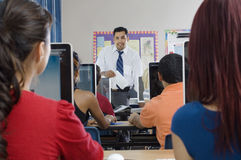 Students With Professor In Modern Classroom Stock Images
