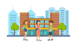 Students and pupils on background of modern university and school. Royalty Free Stock Photos