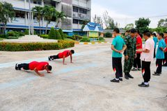 Students are pushing up as the punishment in or to come to school late in the deicipline conduct at Paknampran wittaya school royalty free stock photo