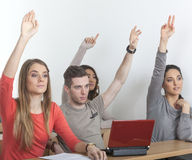 Students put up their hands Stock Photos